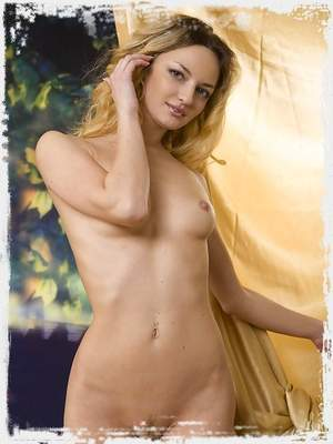 Nude blonde exposes her pussy against gold ; Sinful Goddesses