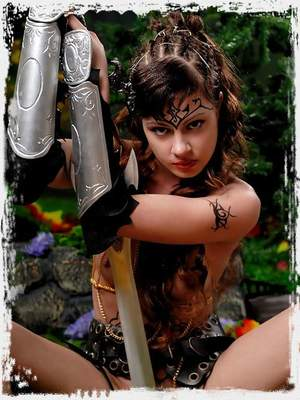Savage brunette amazon babe with body paintings