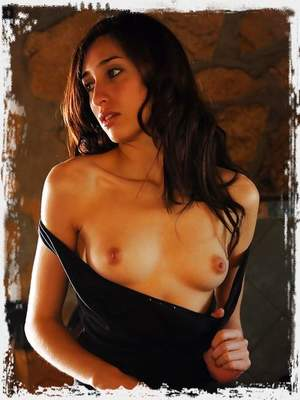 Carol O has the whole house to herself and there's no one to bother her for her me-time. She undresses her body-hugging dress and starts pleasuring her moist, need pussy.