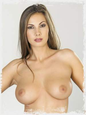 Connie Carter strips and exposes her juicy breasts and wet pussy